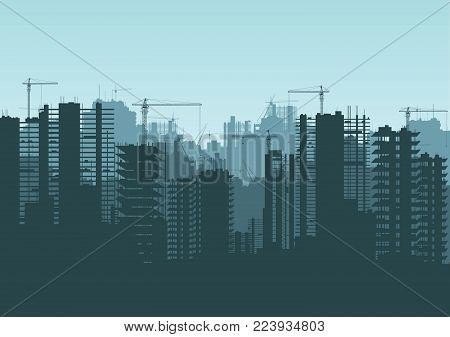 Buildings under construction and building cranes.  Buildings under construction and building cranes.