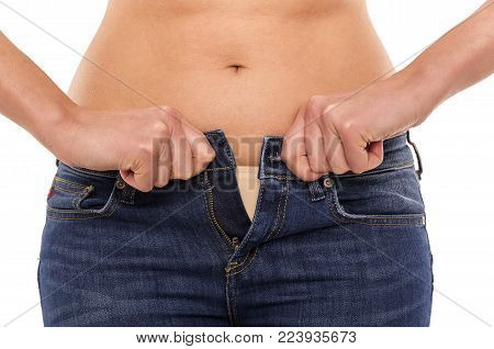Excess weight. You can not zip up your jeans. Isolated on white background.