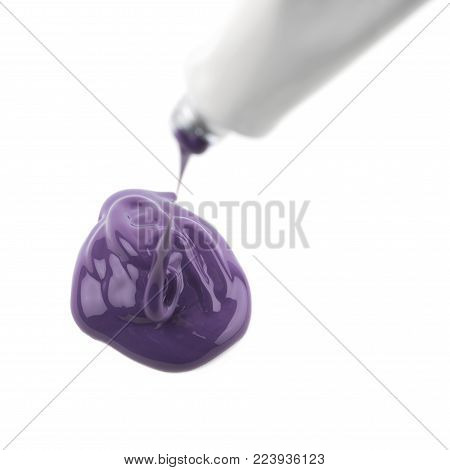 Paint spilling out of a dye tube isolated over the white background