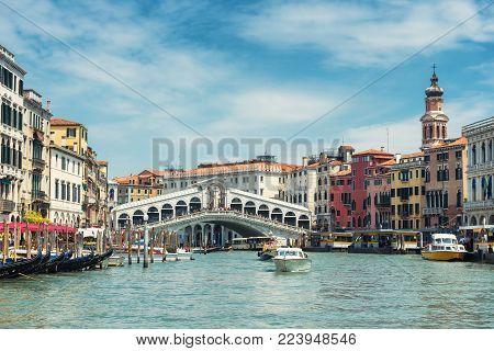 The old Rialto Bridge over the Grand Canal in Venice, Italy. Rialto Bridge (Ponte di Rialto) is one of the main tourist attractions of Venice.