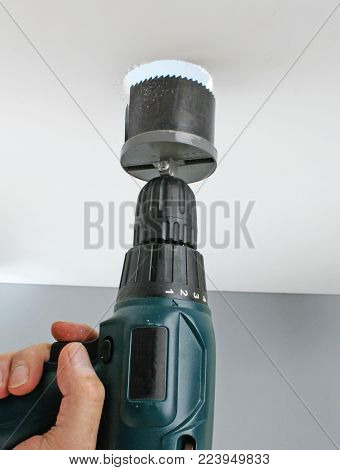 Drilling a hole in the ceiling for light fixture poster