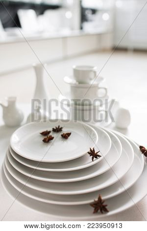Restaurant white tableware assortment. Stylish crockery set. Purity and luxury concept