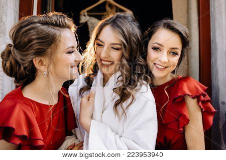 Positive moment of the bride with friends before wedding