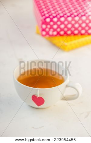 Cup Of Tea With Heart Shaped Teabag Tag