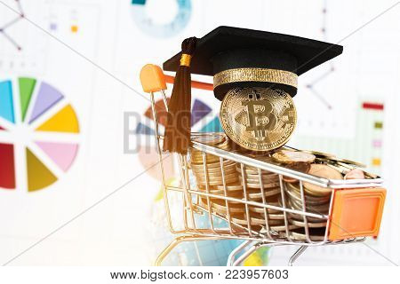 Graduation cap on Bitcoin Cryptocurrency on Coins shopping cart, blur report chart. Concept of Blockchain Transaction System, Bitcoin payment buying for Education certificate of Abroad program