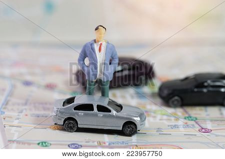 Miniature business people and three Cars on Bangkok city map, Concept for travel around direction to destination with car dealer, cars exhibition show or car insurance for sale customers.