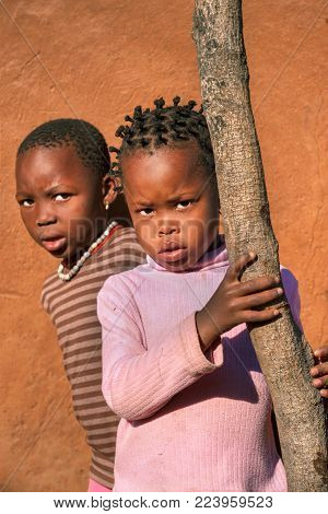 African brothers in the back of the house in the village, Botswana