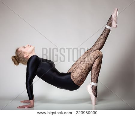 modern style beautiful woman ballet dancer full length studio picture gray background