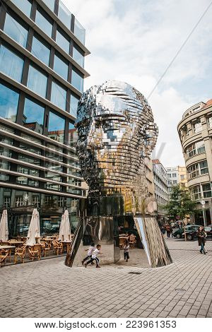 Prague, September 25, 2017: The sculpture of Franz Kafka stands near the shopping center called Quadrio above the metro station, which is called Narodni Trida.
