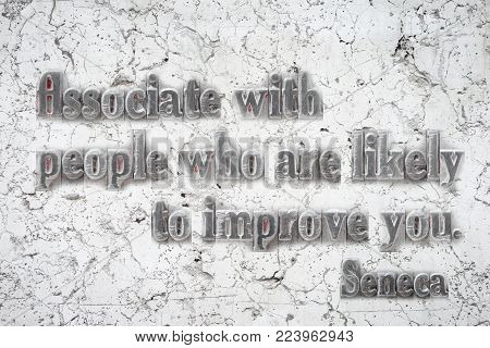 Associate with people who are likely to improve you - ancient Roman philosopher Seneca quote mounted on white marble wall