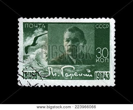 MOSCOW, USSR - CIRCA 1943: canceled stamp printed in the USSR (Soviet Union) shows Maxim Gorky aka Alexei Maximovich Peshkov (1868-1936), famous Russian writer, dramatist, politician, circa 1943. vintage postal stamp isolated on black background.