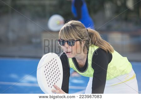 Two Women 47 Years Old Playing Paddle Tennis, Tennis Ball At Net