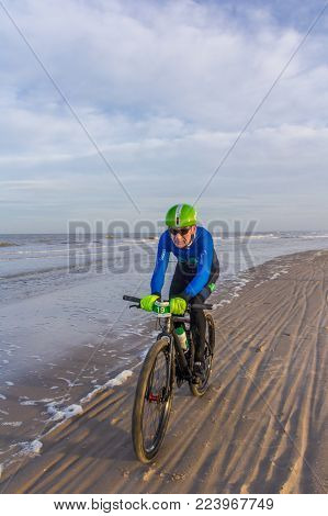 Kijkduin, The Hague, the Netherlands - 28  January 2018: Beach racing bike competition riders in beach race in The Hague, the Netherlands
