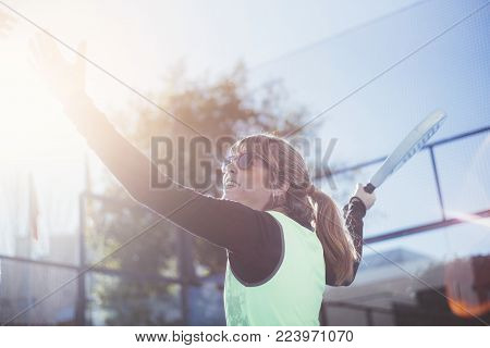 One Women 47 Years Old Playing Paddle Tennis