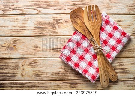 Kitchen table with  utensil and tablecloth. Top view copy space on wooden table.