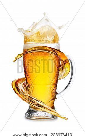 lager beer in mug with splash isolated on white background. Beer splash. Pub alcohol drink. Spiral jet of beer. Alcohol wave