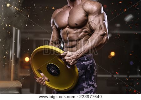 Brutal strong bodybuilder athletic man pumping up muscles workout bodybuilding concept background - muscular bodybuilder handsome men doing exercises in gym naked torso