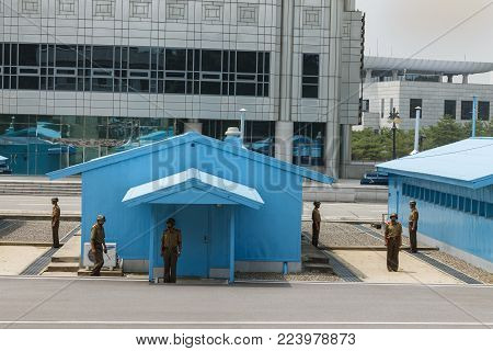 PANMUNJOM, North Korea - 30 July 2014: Soldiers of the North Korean army are on the border with South Korea. View from North Korea.