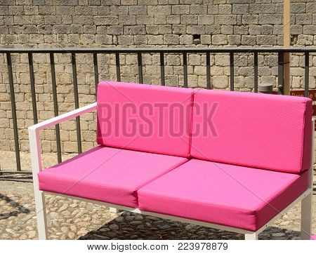 Fucsia sofa  in the old town of Girona,  Catalonia, northeastern Spain.