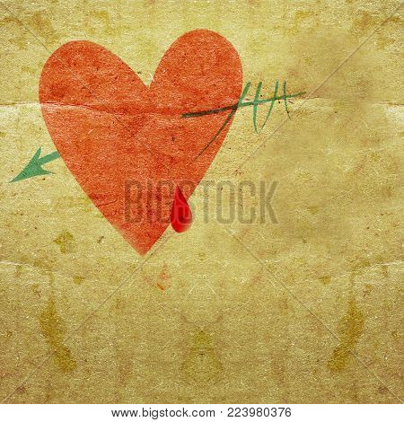 heart with an arrow, and drops of blood on the background grunge board