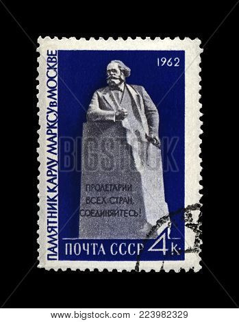 MOSCOW, USSR - CIRCA 1962: canceled postal stamp printed in the USSR shows Karl Marx monument in Moscow, famous politician leader, Capital book author, circa 1962. Vintage stamp isolated on black background.