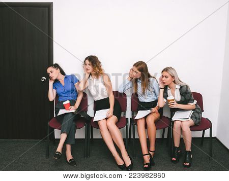 women overhear a competitor's interview. competition in hiring. open vacancy