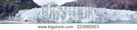 The panoramic view of a glacier in Glacier Bay national park (Alaska).
