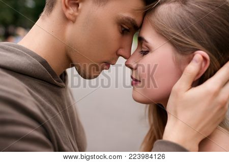 couple in love walking in the park. street romance. tenderness and care