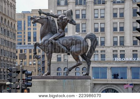 CHICAGO - MAY 5, 2011 - The Bowman, bronze sculpture of native american on horse, standing in Congress Plaza, at the intersection of Congress Parkway and Michigan Avenue in Chicago's Grant Park.