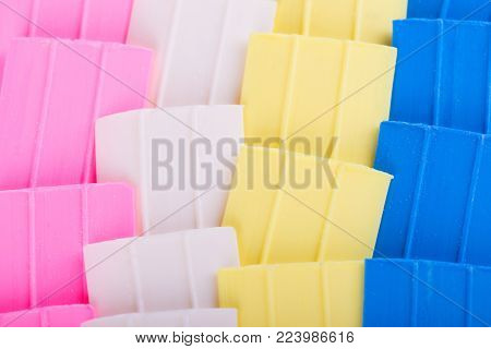 Tailor chalk. Colorful chalk for sewing. Background of colored chalk. Chalk of different colors for tailor's work