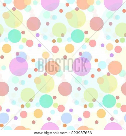 Seamless texture with transparent multi-colored sweets. Large and small colored circles. Vector festive pattern for wrapping paper, for fabric, for background and for your creativity.