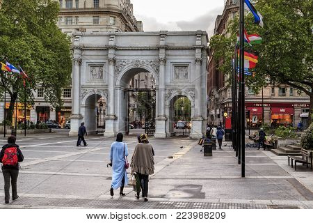 LONDON, GREAT BRITAIN - MAY 10, 2014: The Marble Arch is a triumphal arch, standing near the Oratory corner in Hyde Park.