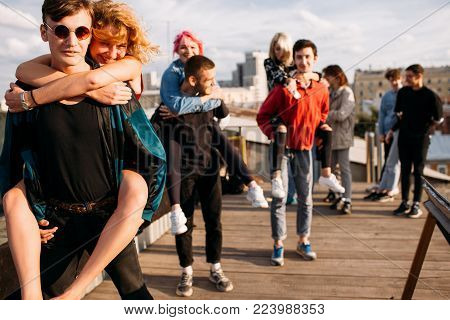 Friends unity dreams freedom concept. Young group of diverse friends laugh bonding and have fun