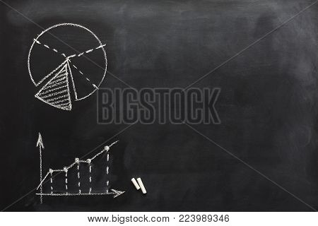 Conceptual educational or business diagrams background. schematic results and growth graphs and charts and drawn with chalk on blackboard with copy space