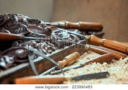 Joinery work. Wood carving. Chisels for carving close up. Small depth of field. poster