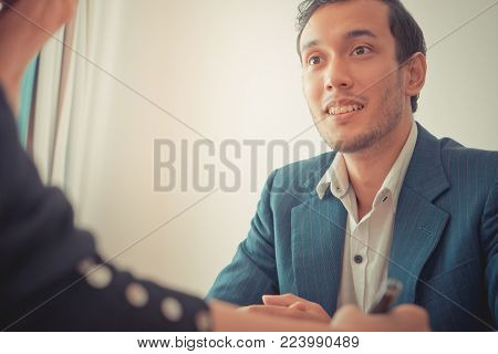 Business man looking interested while dealing with business partner