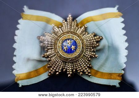 Order of the Three Stars is an order awarded for meritorious service to Latvia. On its edge there is inscription - Par Teviju - English: For Fatherland.