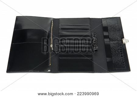 Black leather glancy wallet for woman. It has a metallic zipper and many sections for paper money, coins, credit cards. Comfortable for carrying in bag. Photo was made on the white studio background.