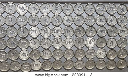 Surface of many lids for tin cans glued together on metal plate