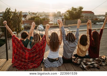 Group of diverse young people celebrating freedom. Inspiration motivation carefree lifestyle concept. Bonds of friendship