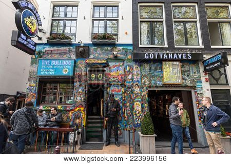 Amsterdam, Netherlands - April 20, 2017: The Bulldog coffee shop in the Red Light District of Amsterdam, Holland, the Netherlands