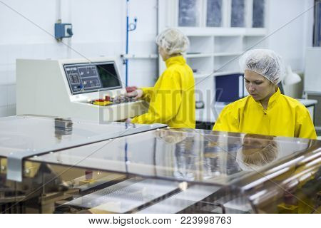Pharmaceutical Manufacturing Technicians On The Production Line . Medical Vaccine Manufacturing.