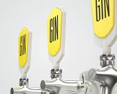 A row of three slick modern white and chrome draught gin taps on an isolated white studio background with copy space - 3D render poster
