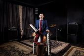 professional musician with studio keyboard synthesizer, accordion and harmonic poster