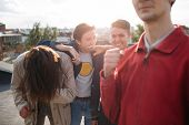 laughing hipster gang. Bff have fun enjoying a joke. Carefree mischievous teenage friends hanging out together poster