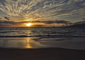 Landscape with sunset sky and ocean at Maui, Hawaii.