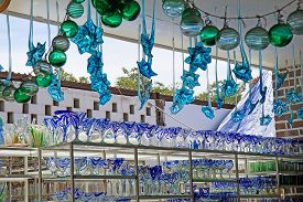 CABO SAN LUCAS, MEXICO - April 8, 2014: Stands with colorful mexican wine glasses, vases and glass decorations at Los Cabos glass factory store