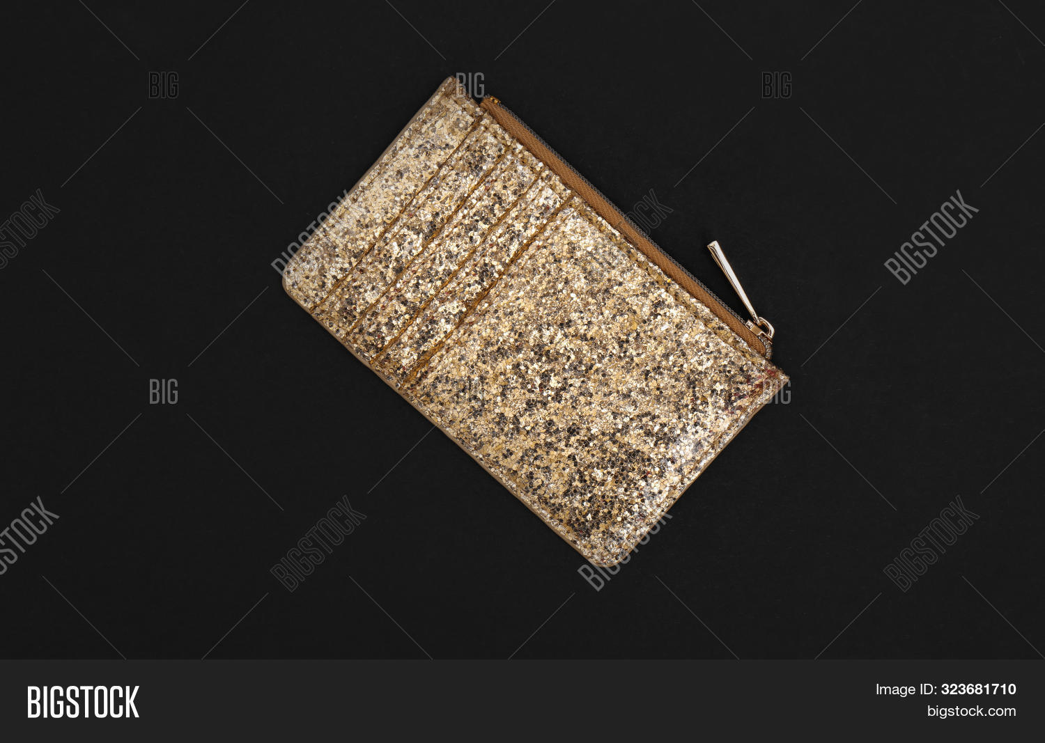 Elegant Shining Gold Purse On Black Background, Top View
