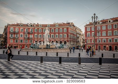 Nice, France - November 3, 2016: Sun Fountain (fontaine Du Soleil) And The Apollo Statue On The Mass