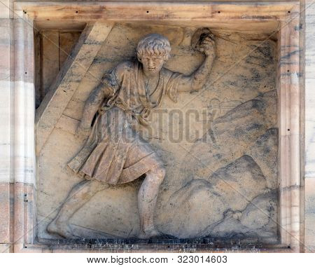 MILAN, ITALY - JUNE 22, 2018: Samson carries away the Gates of Gaza. Marble relief on the facade of the Milan Cathedral , Duomo di Santa Maria Nascente, Milan, Lombardy, Italy
